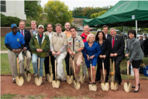 Freeholder Director Mark Caliguire (back row, third from right) and Freeholder Deputy Director Patricia Walsh (front row, center) take part in the Enabling Garden groundbreaking ceremony at RVCC.